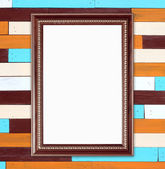 Blank wood frame on colorful wood wall background — Stock Photo