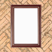 Blank wood frame on brick stone wall  — Stock fotografie