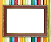 Wood frame on colorful bamboo wall — Stock Photo