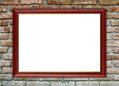 Blank wood frame on brick stone wall  — Stock Photo