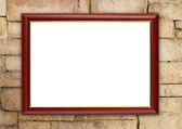 Blank wood frame on brick stone wall — Stock Photo