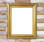 Golden frame on brick stone wall background — Stock Photo