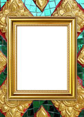 Golden frame on Thai style buddha wall background — Stock Photo