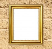 Golden frame on brick stone wall background — Stock Photo
