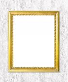 Golden frame on cement wall background — Stock Photo