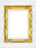 Golden frame on wood wall background — Stock Photo