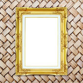 Golden frame on bamboo texture background — Stock Photo