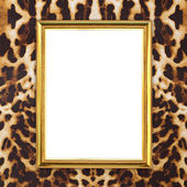 Golden frame with leopard texture background — Stock Photo