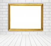 Blank golden frame in room with white wood wall (block style) an — Stock Photo