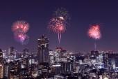 Fireworks celebrating over Tokyo cityscape at night — Stock Photo