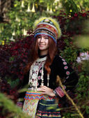 Traditionally dressed Mhong hill tribe woman in the garden — Stock Photo