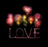 Love sparkler firework light alphabet with fireworks — Stock Photo