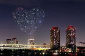 Heart sparkle Fireworks celebrating over Odaiba, Tokyo cityscape — Stock Photo