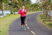 Young healthy asian woman running — Stock Photo