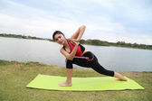 Young woman doing yoga exercise — Стоковое фото
