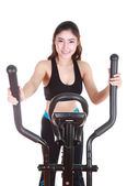 Young woman doing exercises with exercise machine — ストック写真