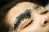 Makeup eyebrow tattooing, pretty asian woman face closeup — ストック写真
