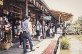 Phra Nakhon Si Ayutthaya, Thailand - April 14, 2015: Ayothaya Floating Market. Has a many visitors, both Thais and foreign visitors with varieties of Thai clothes and Thai food at Ayutthaya,Thailand — Stock Photo
