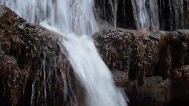 Stream waterfall close up in nature,Pa Chareon waterfall national park in Thailand — Stock Video
