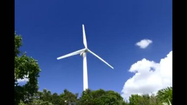 Time lapse beautiful wind turbines generating electricity with blue sky background in Thailand — Stock Video