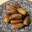 Souvenirs from Tunisia: dates and saucer — Stock Photo #75202593