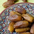 Souvenirs from Tunisia: dates and saucer — Stock Photo #75234051