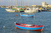 Typical fishing rowboats called gozzo in little port of Bari Palese — Stock Photo
