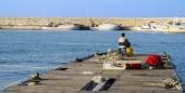 Bir bağlantı noktası iskelede oturup balıkçı — Stok fotoğraf