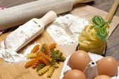 Pasta and ingredients for pasta — Stock Photo