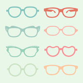 Set of vector glasses set with colored thick support.  — Wektor stockowy