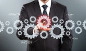 Businessman Activate Gears — Stock Photo