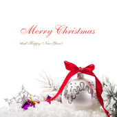 Christmas tree ornaments on white background with copy space — Stock Photo