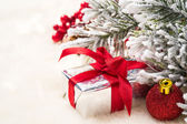 Christmas gifts and decorations on the background of fir branche — Stock fotografie
