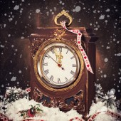 Vintage wooden clock surrounded by Christmas decorations — Stock Photo