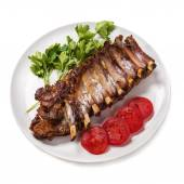 Baked pork ribs with vegetables isolated on white background — Stock Photo