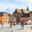 BRASOV, ROMANIA - JULY 15: Council Square on July 15, 2014 in Brasov, Romania. Brasov is known for its Old Town, which is a major tourist attraction includes the Black Church, Council Square and medie — Stock Photo #52107523