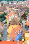 SIGHISOARA, ROMANIA - JULY 17: Aerial view of Old Town in Sighisoara, major tourist attraction on July 17, 2014. City in which was born Vlad Tepes, Dracula — Stockfoto