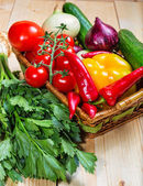 Close up of various colorful raw vegetables in a basket — Stock Photo