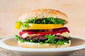 Close up of hamburger on white plate — Stock Photo