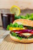 Hamburger and drink with slice of lemon  — Stock Photo