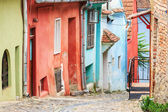 Medieval street view in Sighisoara founded by saxon colonists in — Stock Photo