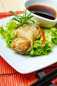 Fried spring rolls on red bamboo mat — Stok fotoğraf
