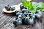 Blueberry on wooden board — Stock Photo