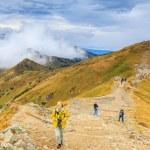 Zakopane, POLAND - September 13: Group of tourists walk to the top of the Kasprowy Wierch in Tatra Mountains on September 13, 2014 in Tatra Mountains, Poland. — Stock Photo #57731411