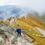 Zakopane, POLAND - September 13: Group of tourists walk to the top of the Kasprowy Wierch in Tatra Mountains on September 13, 2014 in Tatra Mountains, Poland. — Stock Photo #57731451