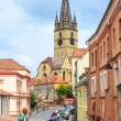 Sibiu, Romania - July 19, 2014: Old Town Square in the historical center of Sibiu was built in the 14th century, Romania — Stock Photo #60030947