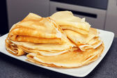 Sweet pancake on white plate — Stock Photo