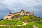 Rasnov, Romania - July 16, 2014: Tourists visit the medieval castle in Rasnov. Fortress was built between 1211 and 1225 — Stock Photo