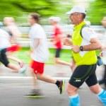KRAKOW, POLAND - MAY 18 : Cracovia Marathon. Runners on the city streets on May 18, 2014 in Krakow, POLAND — Stock Photo #62620443