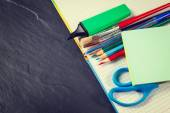 School supplies on black background, vintage color tone — Stock Photo